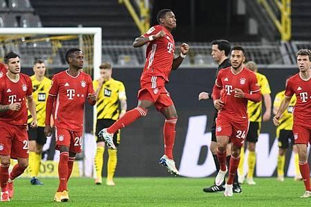 Bayerns David Alaba (M) feiert den Ausgleich zum 1:1. Foto: Bernd Thissen/dpa-Pool/dpa