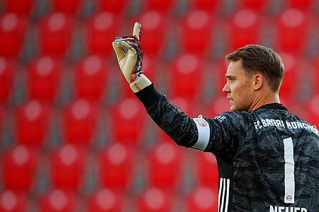 Hat seinen Vertrag beim FCBayern verlängert: Kapitän Manuel Neuer. Foto: Hannibal Hanschke/Reuters-Pool/dpa