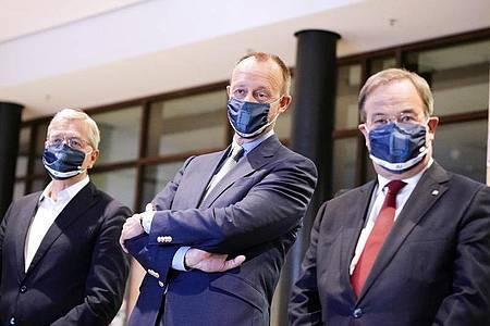 Die drei Kandidaten für den Bundesvorsitz der CDU: Armin Laschet, (r-l) Friedrich Merz und Norbert Röttgen. Foto: Michael Kappeler/dpa-pool/dpa