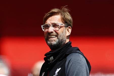 Geht entspannt mit dem vom FC Liverpool verpassten Punkterekord in der Premier League um: Trainer Jürgen Klopp. Foto: Cath Ivill/Pool Reuters/AP/dpa