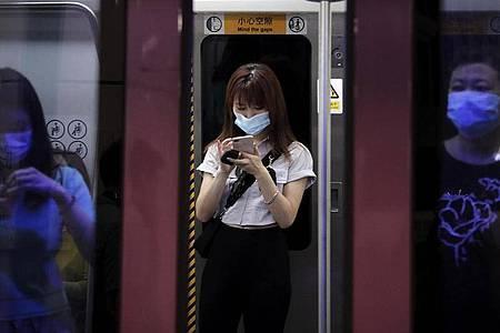 Die Zahl der Corona-Fälle inChina steigt trotz strenger Anti-Corona-Maßnahmen. Foto: Andy Wong/AP/dpa
