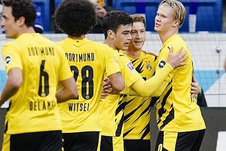 BVB-Kapitän Marco Reus (2.v.r.) sorgte für drei Dortmunder Punkte bei 1899 Hoffenheim. Foto: Uwe Anspach/dpa