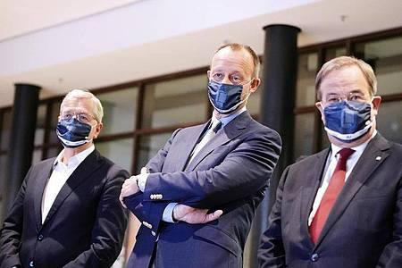 Der neue CDU-Vorstizende - hier die drei Kandidaten Norbert Röttgen, Friedrich Merz und Armin Laschet - soll am 4. Dezember Stuttgart gewählt werden. Foto: Michael Kappeler/dpa-pool/dpa