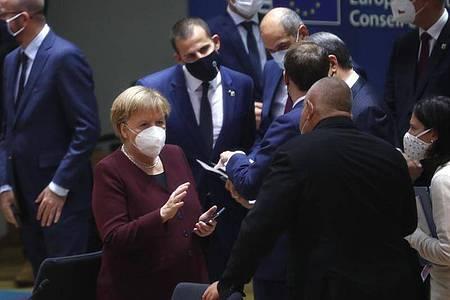 Bundeskanzlerin Angela Merkel im Kreis der Staats- und Regierungschefs beim EU-Gipfel in Brüssel. Foto: Francisco Seco/AP Pool/dpa