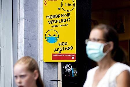 An belebten Orten in Amsterdam ist das Tragen eines Mund-Nasen-Schutzes Pflicht. Foto: sem Van Der Wal/ANP/dpa