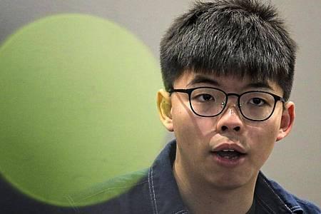 Der Demonkratie-Aktivist Joshua Wong ist in Hongkong festgenommen worden. Foto: Kin Cheung/AP/dpa