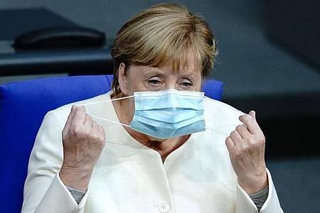 Eine Rede der Bundeskanzlerin Angela Merkel über den Haushalt wird erwartet. Foto: Kay Nietfeld/dpa