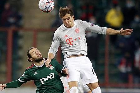 Leon Goretzka (r) köpfte Bayern früh inMoskau in Führung. Foto: Maxim Shemetov/Reuters Pool/dpa