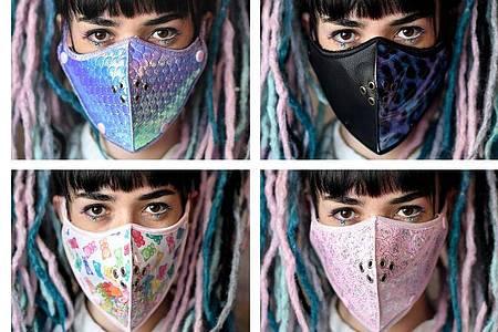 Die Designerin Hadas Foguel zeigt Mundschutz-Masken ihres Labels «Foguelina». Foto: Britta Pedersen/dpa-Zentralbild/dpa