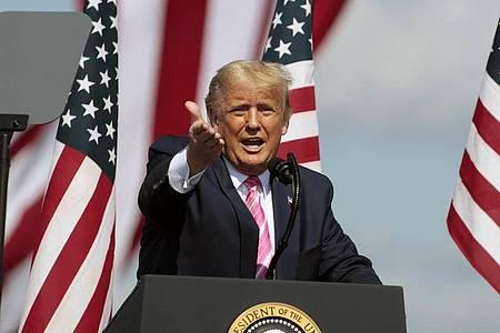 Macht Corona zu einer Glaubensfrage: US-Präsident Donald Trump spielt die Gefahr herunter. Foto: Chris Seward/AP/dpa