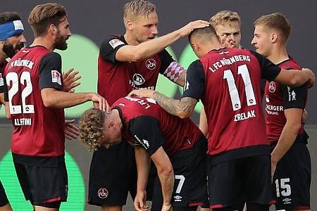 Mit dem 2:0-Sieg im Hinspiel haben die Nürnberger beste Aussichten sich gegen den FC Ingolstadt in der Relegation zu behaupten. Foto: Daniel Karmann/dpa