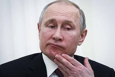 Das dürfte Kremlchef Putin nicht begeistern:Die Mehrheit der Russen ist für eine Altersbeschränkung des Präsidenten. Foto: Maxim Shemetov/Pool reuters/AP/dpa