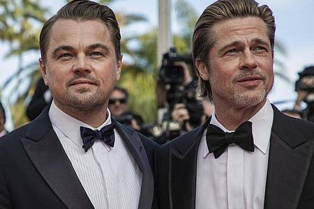 Leonardo DiCaprio (l) und Brad Pitt bei der Premiere von «Once Upon a Time in Hollywood» 2019 in Cannes. Foto: Vianney Le Caer/Invision/AP/dpa