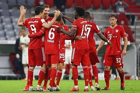 Der FC Bayern München kann am Wochenende schon deutscher Meister werden. Foto: Kai Pfaffenbach/Reuters/Pool/dpa