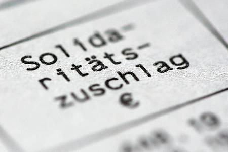 Die FDP fordert eine vollständige Soli-Abschaffung zum 1. Januar 2020. Foto: Roland Weihrauch/dpa