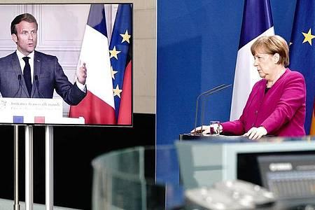 Angela Merkel und Emmanuel Macron, per Video zugeschaltet, bei einer gemeinsamen Pressekonferenz im Mai. Foto: Kay Nietfeld/dpa-Pool/dpa