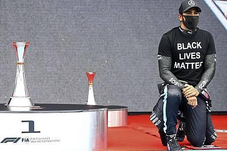 Zeigt klare Kante gegen Rassismuns: Formel-1-Weltmeister Lewis Hamilton. Foto: Mark Thompson/Pool Getty/dpa