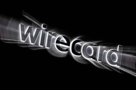 Das Logo von Wirecard an der Fassade des Firmensitzes in Aschheim bei München. Foto: Peter Kneffel/dpa