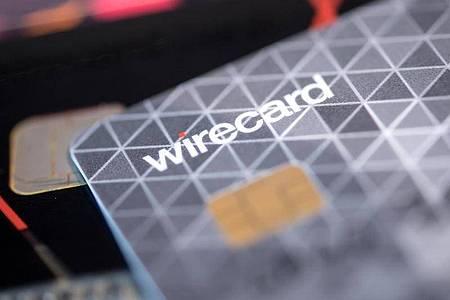Eine Kreditkarte des Bezahldienstleister Wirecard in einem Showroom des Unternehmens. Foto: Sven Hoppe/dpa