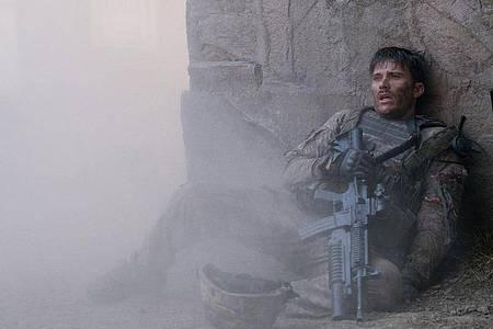 Scott Eastwood spielt den Staff Sergeant Clint Romesha, der mit seinen Kameraden in Afghanistan ums Überlegen kämpft. Foto: -/Telepool/dpa