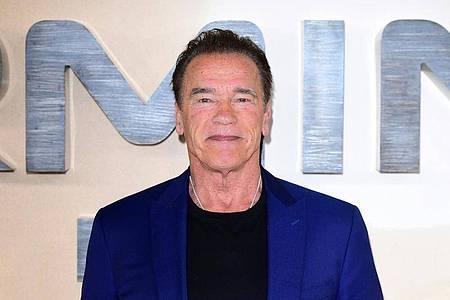 Arnold Schwarzenegger dreht Filme mit seinen tierischen Mitbewohnern. Foto: Ian West/PA Wire/dpa
