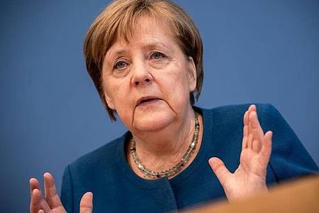 Bundeskanzlerin Angela Merkel: «Wir sind ... am Anfang einer Entwicklung, die wir noch nicht genau voraussehen können.». Foto: Michael Kappeler/dpa