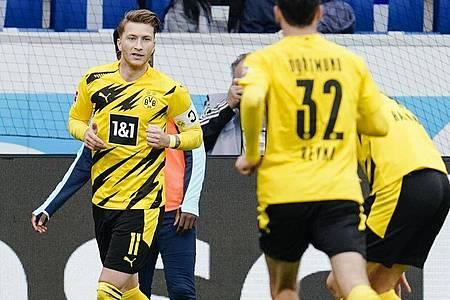 BVB-Kapitän Marco Reus (l) war Dortmunds Matchwinner in Sinsheim. Foto: Uwe Anspach/dpa