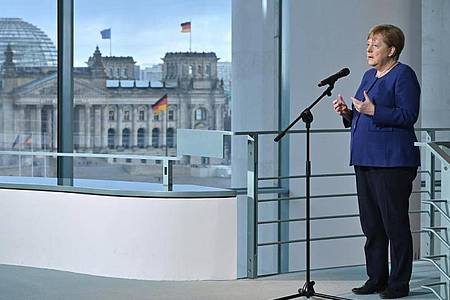 Kanzlerin Merkel über die Coronavirus-Krise: «Eine Herausforderung, wie wir sie seit langem nicht gekannt haben». Foto: John Macdougall/POOl AFP/dpa