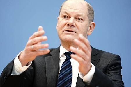 Finanzminister Olaf Scholz vergangene Woche während einer Pressekonferenz zu den wirtschaftlichen Auswirkungen der Coronakrise. Foto: Kay Nietfeld/dpa
