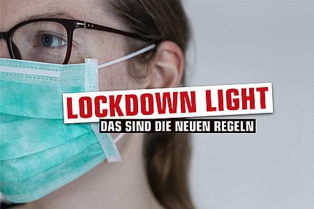 lockdown light - frau mit maske