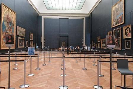 Der Weg zur «Mona Lisa» im Louvre ist stark gesichert. Foto: Sabine Glaubitz/dpa